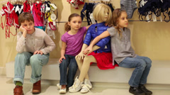 Two girls and a boy posing next to a mannequin in clothes Stock Footage