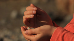 Stones in the hands Stock Footage