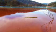 Stock Video Footage of Copper mining residuals in a lake. Ecological catastrophe in Geamana, Romania