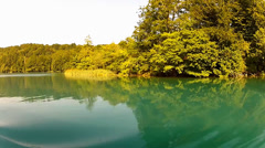Lake water passing view from a moving boat at Plitvice, Croatia Stock Footage