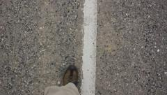 Walking on the road Stock Footage