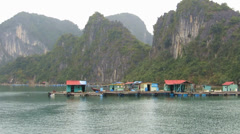Floating villages in Halong Bay, Vietnam Stock Footage