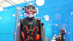 Black diving suit at the exhibition on the glazed stand Stock Footage
