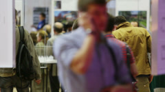 People in hall at International Exhibition Stock Footage