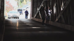 Cars and pedestrians entering covered bridge (4 of 4) Stock Footage