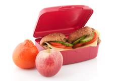 lunchbox with healthy bread rolls - stock photo