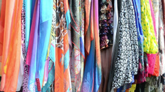Multicolor cloaks shawls and scarves sold in market fair Stock Footage
