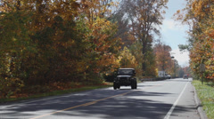 A two-lane road in Autumn (1 of 2) Stock Footage