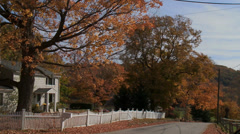 Country road with house in Autumn (2 of 3) - stock footage