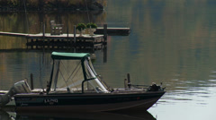 Small fishing boat docked in water (2 of 2) Stock Footage
