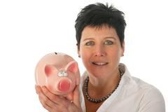 woman is holding piggy bank - stock photo