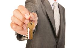 house broker with keys - stock photo