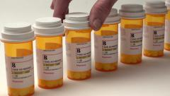 Slider shot of medication bottles in a row Stock Footage