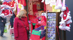 woman shopping at christmas market, england - stock footage