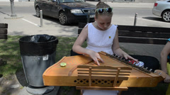 Young girl hands synchronise Baltic psaltery string instrument Stock Footage