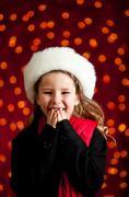 christmas: giggling christmas holiday girl - stock photo