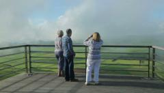 Tourists looking at hills and fields, Terceira Island, Azores Stock Footage