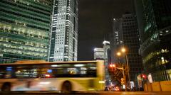 Urban traffic passing skyscraper,night illuminated cityscape,shanghai china. Stock Footage