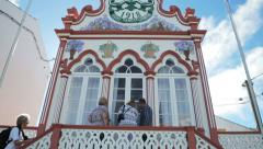 Tourists visiting holy spirit house, terceira island, Azores, Portugal Stock Footage
