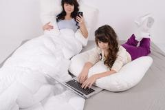 young girl is working in the bed - stock photo
