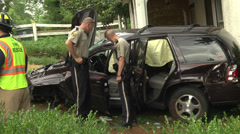 Cars hits house police inspect Stock Footage