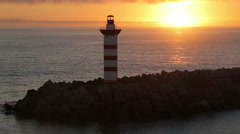 Sunrise at harbour lighthouse, praia do vitoria, terceira island, azores Stock Footage