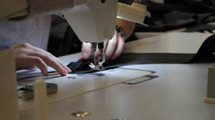 Sews on sewing machine 2 Stock Footage