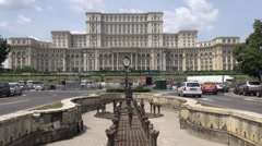 Traffic in Bucharest, Romania, the Palace of the Parliament, city street Stock Footage