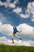 Happy jumping man Stock Photos