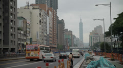 A busy Taipei street with the 101 tower in the background Stock Footage