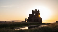 Sunset time lapse over Whitby Abbey, Yorkshire, UK Stock Footage