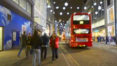 London, Oxford Street at night before Christmas with Traffic and people walking Stock Footage