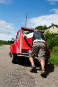 French man with car break down Stock Photos