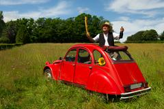 French man with his typical red car Stock Photos