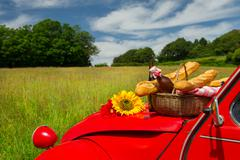 french car with bread and wine - stock photo
