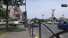 Cars in traffic in Bucharest Romania on large boulevard with tramway bus Stock Footage