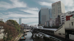 A busy downtown Tokyo train station Stock Footage