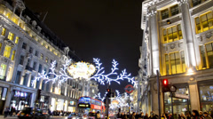 London, Buses and cars drive through Regent Street under the Christmas lights Stock Footage