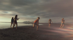 Group of Five Teenage Girls Running, Chasing On The Beach At Sunset - stock footage