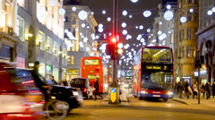 Christmas lights and London buses at the station on busy Oxford Street London - stock footage