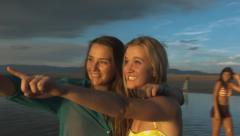 Group of Teenage Girls On The Beach At Sunset Stock Footage
