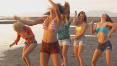 Group of Five Teenage Girls Dancing For The Camera On The Beach Stock Footage