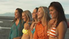 Group of Five Chatty Teenage Girls Standing, Looking Into The Sun On The Beach Stock Footage