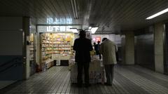 People reading at underground bookstore, Shinjuku, Tokyo Stock Footage