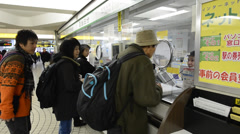 JR information office in Shinjuku underground, Tokyo Stock Footage