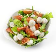 Healthy fresh rucola salad with mozarella and tomato slices Stock Photos
