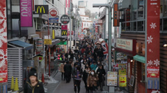 Busy shoppers on Takeshita street in Harajuku, Tokyo, Japan Stock Footage