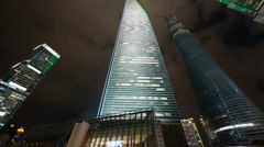 Time lapse,clouds passing urban skyscraper at night,shanghai finance center. Stock Footage