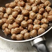 Tasty meatballs beeing prepared in a frying pan Stock Photos