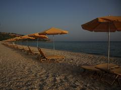 Sunbeds and parasols kefalonia Stock Photos